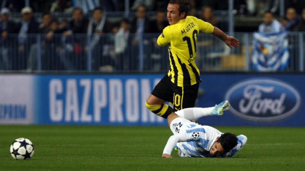 <strong>GOD MOTTAKELSE:</strong> Mario Götze fikk en mild mottakelse på hjemmebane i kveld, til tross for misnøyen rundt hans Bayern München-overgang. Foto: REUTERS/Jon Nazca