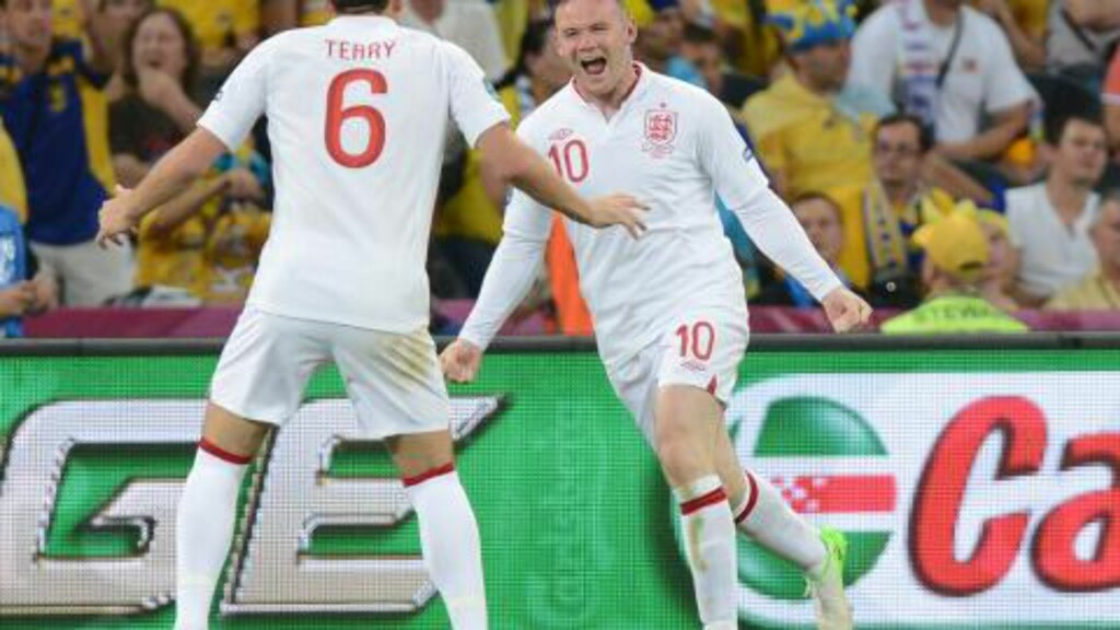 JUBEL: Wayne Rooney jubler etter scoring mot Ukraina. Foto:     AFP PHOTO / PATRICK HERTZOG