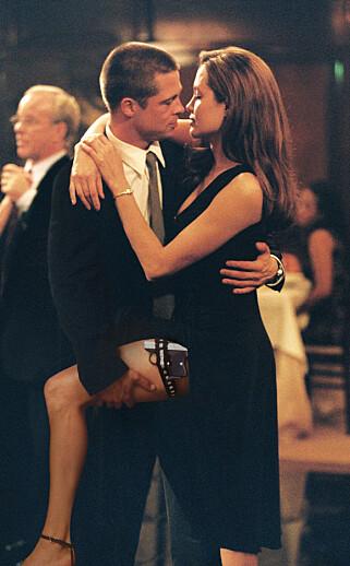 IKKE BARE PÅ FILM: Brad Pitt erkjente at han ble forelsket i Angelina Jolie under innspillingen av «Mr. & Mrs. Smith». Foto: NTB Scanpix