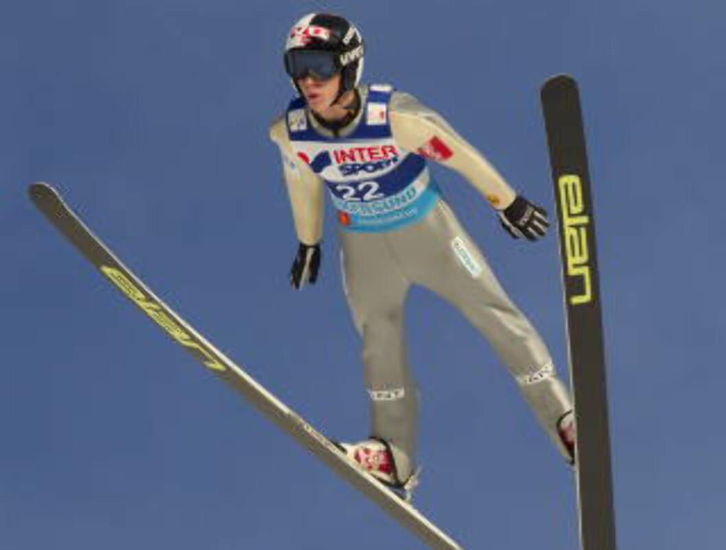 <strong>DAGENS LENGSTE:</strong>  Anders Fannemel hoppet 244,5 meter. Foto: Terje Bendiksby / Scanpix