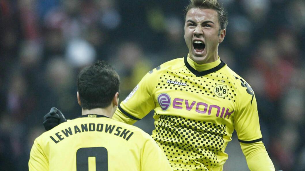 Mario Götzes 1-0-scoring avgjorde borte mot Bayern München og sørget for at Borussia Dortmund tok et solid av jafs av gjestenes forsprang på toppen av Bundesliga.  Foto: AFP PHOTO / GUENTER SCHIFFMANN