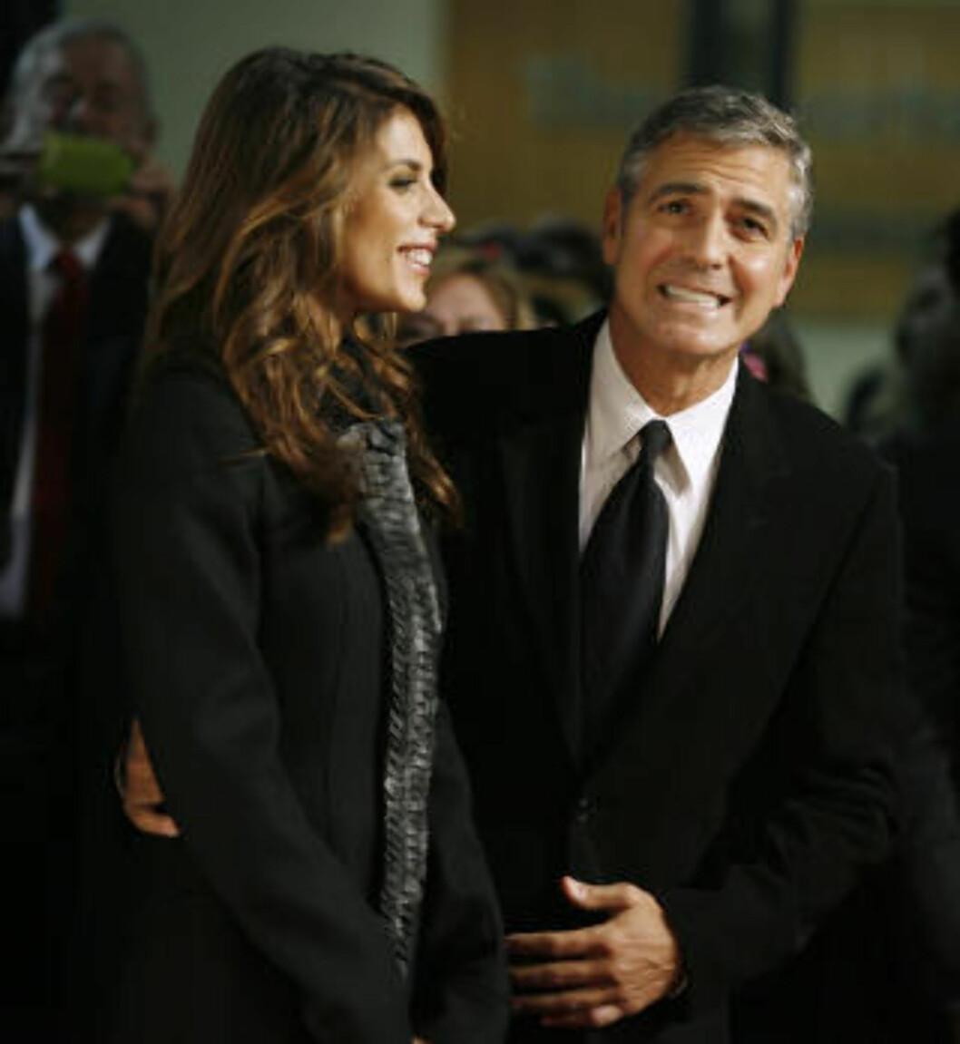 MÅ I RETTEN? George Clooney - her med sin italienske kjæreste Elisabetta Canalis. Foto: AFP/Scanpix