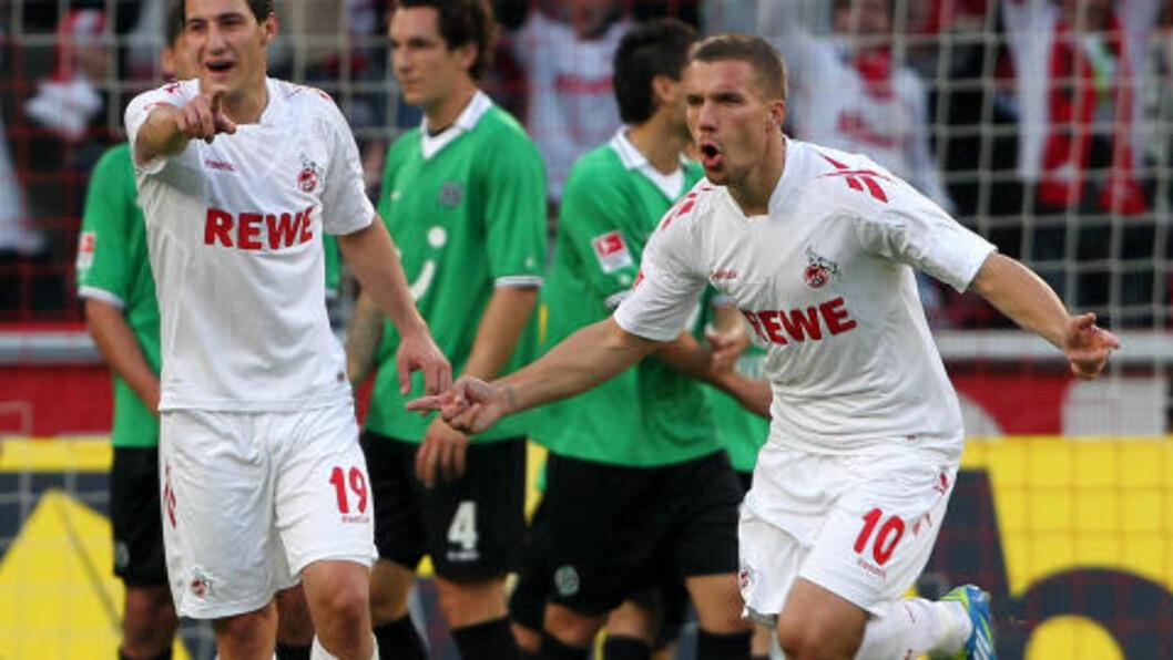 <strong>HELT:</strong> Lukas Podolski scoret begge målene for Köln. Foto: AFP PHOTO / ROLAND WEIHRAUCH