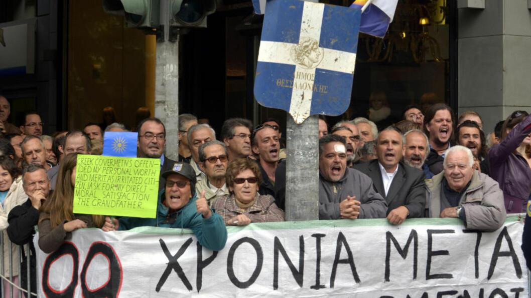 <strong>TVILER:</strong> Grekere flest har ingen tro på EUs nye kriseplan selv om Hellas får slettet deler av statsgjelden. Foto: AP Photo/Nikolas Giakoumidis)