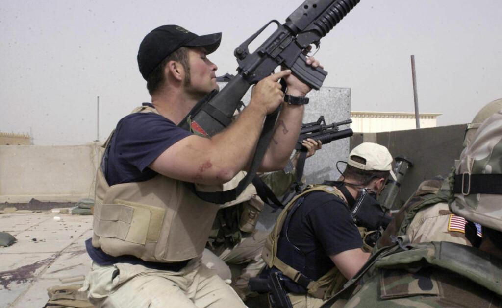 I STRID:  Leiesoldater knyttet til Blackwater i strid i Irak for sju år siden. Nå har selskapets gründer dannet en ny hærstyrke, som skal operere i De forente arabiske emirater. Foto: (AP Photo/Gervasio Sanchez, File)