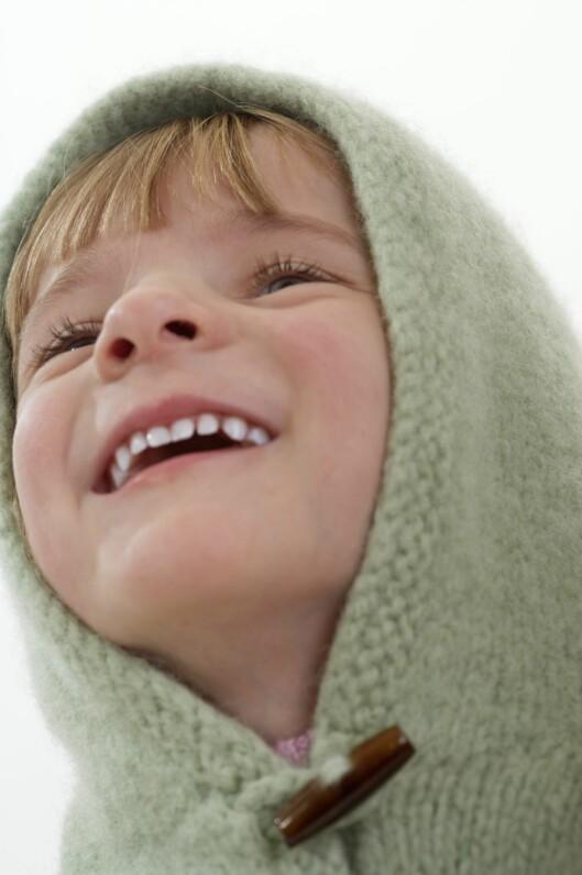 TOPP TIL TÅ: Ull varmer godt, også når den blir våt. Dermed holder ungene varmen bedre.  Foto: Bård Løken/Samfoto