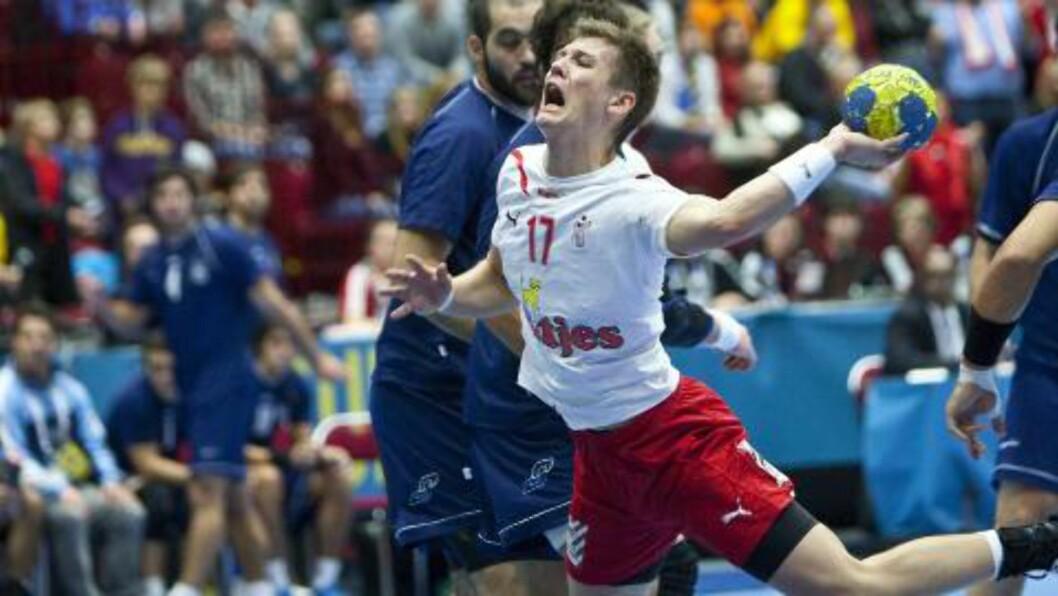 GULLKANDIDAT? Denmark og Lasse Svan er ett av de fire landene som nå kjemper om VM-gullet. Foto: AP/Claes Hall/SCANPIX