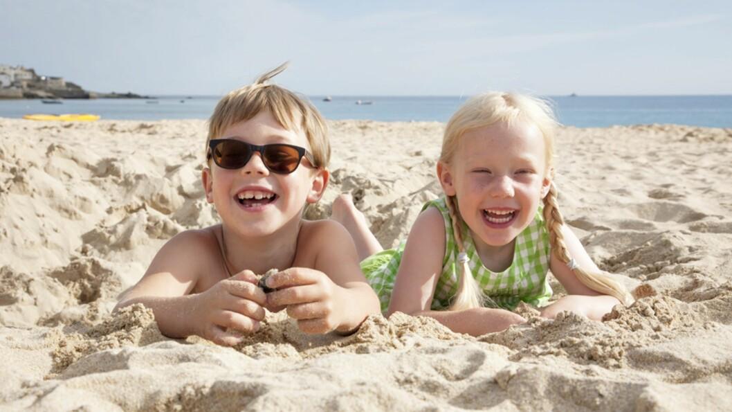 <b>FAMILIENS DRØMMESTRENDER:</b> Deilig myk sand og langgrunn strand er noe av det som må til for å få en vellykket badeferie. Foto: NTB Scanpix