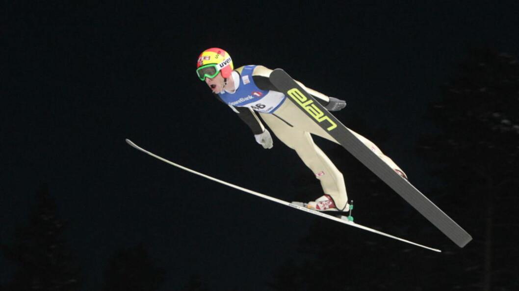 <strong>TIDENES LENGSTE:</strong> Johan Remen Evensen sto uten problemer på 243 meter under prøveomgangen  i Vikersund. Det var fire meter lengre enn Bjørn Einar Romørens tidligere verdensrekord fra Planica i 2005. I kvalifiseringen la han likeså greit på til 246,5 meter.Foto: Terje Bendiksby / Scanpix