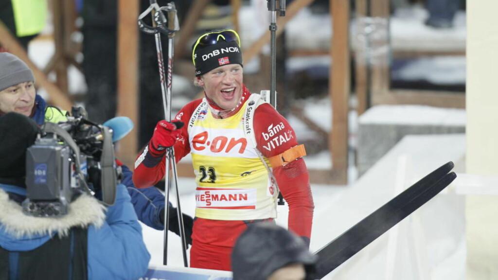 GULLGUTT: Tarjei Bø gikk et glimrende løp på 20 kilometeren og tok sitt andre gull i skiskytter-VM foran Maxim Maksimov og Christoph Sumann. Foto: Heiko Junge / Scanpix