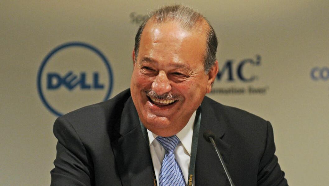 <strong>74 MILLIARD DOLLAR-GLISET:</strong> Meksikanske Carlos Slim Helu har all grunn til å glise med sine 74 milliarder dollar - eller 412 milliarder norske kroner - på bok. Foto: AFP/Greg Wood/Scanpix