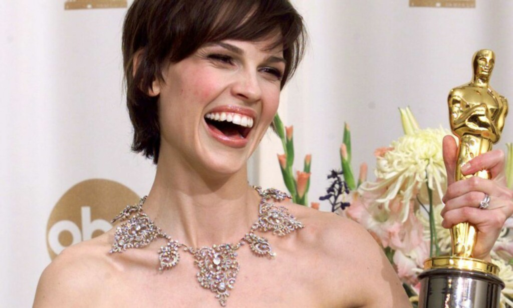 DRO INN OSCAR: Hilary Swank vant i 2000 Oscar for sin rolle i «Boys Don't Cry». Nå avslører hun imidlertid at hun fikk luselønn for rollen, som gjorde at hun ikke engang hadde råd til å betale helseforsikringen sin. <div>Foto: REUTERS, NTB scanpix</div>