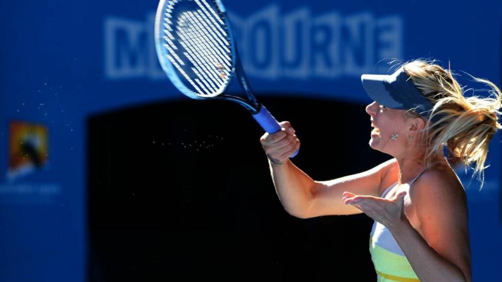 ENKEL VEI: Maria Sharapova tok seg enkelt videre mot landskvinnen Ekaterina Makarova i natt. Foto: AFP / WILLIAM WEST / NTB SCANPIX