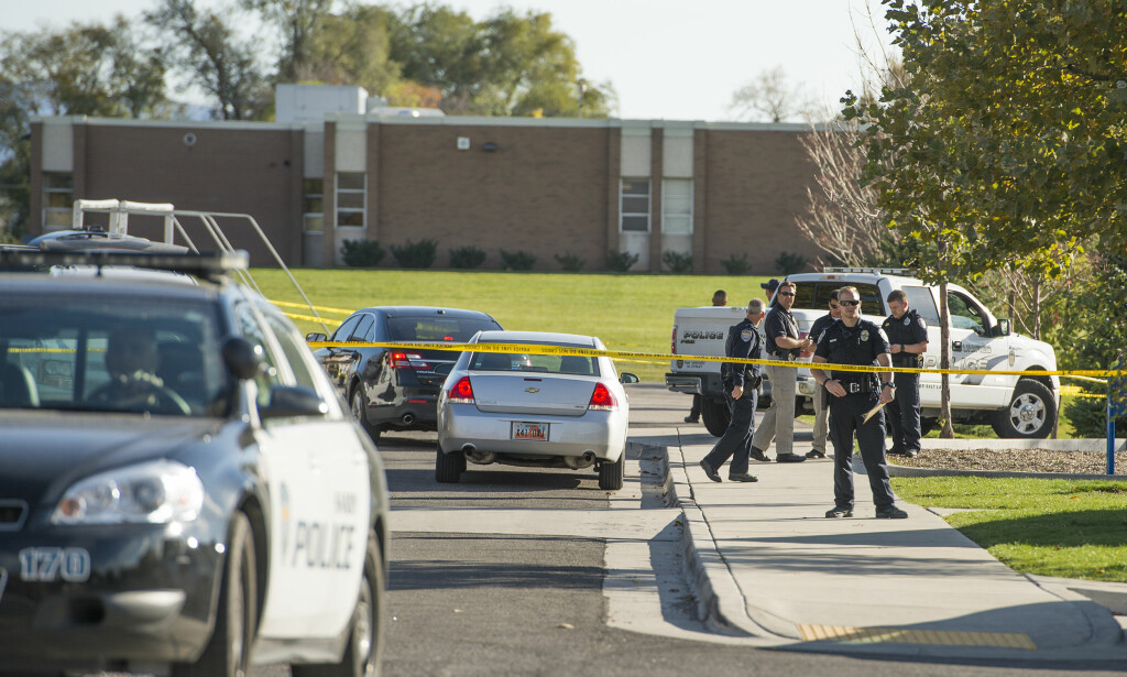 Police officers work the scene after a teen was shot outside Union Middle School in Sandy, Utah, Tuesday, Oct. 25, 2016. A 16-year-old boy was shot twice and critically wounded by another teenager Tuesday afternoon when the two got into argument outside the middle school in a Salt Lake City suburb, authorities said. (Leah Hogsten/The Salt Lake Tribune via AP)