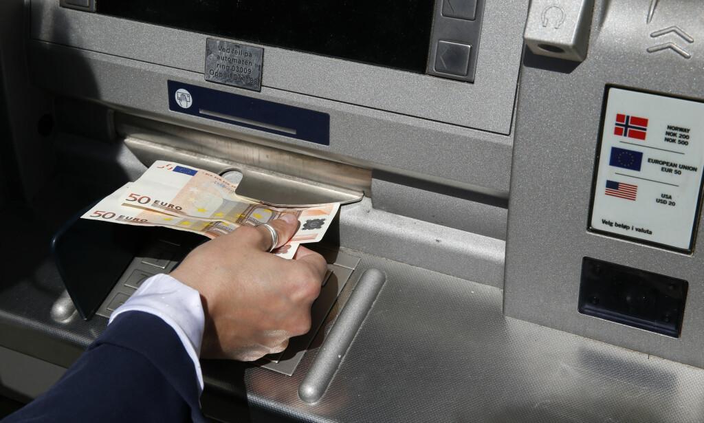 BLIR LURT: Forbrukerrådet hevder at nordmenn blir lurt til å velge en dårlig valutakurs i utlandet. Det vil de ha slutt på. Foto: Vidar Ruud/NTB Scanpix