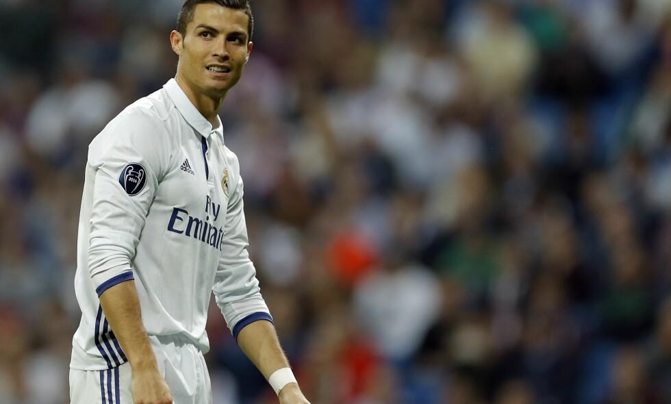 SUPERSTJERNE: Real Madrids Cristiano Ronaldo har ikke noe imot å delta på modelloppdrag når han ikke spiller fotball. Foto: AP Photo/Francisco Seco/NTB Scanpix