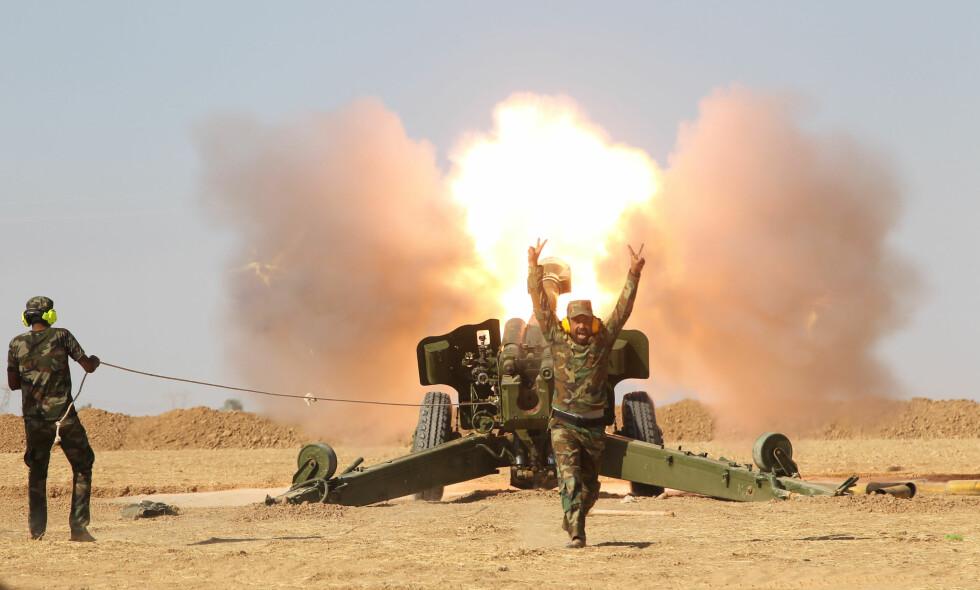 MED HJELP FRA IRAN: Styrker fra Den folkelige mobliseringsstyrken, PMF, startet lørdag angrepet mot IS i byen Tal Afar. Foto: REUTERS/Scanpix NTB