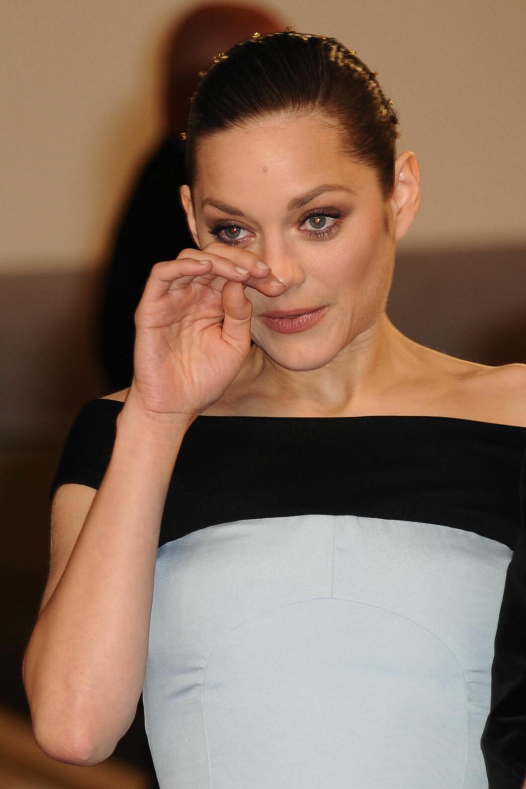 OPPRØRT: Skuespiller Marion Cotillard skal være sjokkert over utroskapsanklager, skriver Daily Mail. Her er hun avbildet etter visningen av «The Little Prince» under filmfestivalen i Cannes i mai.   Foto: Abaca
