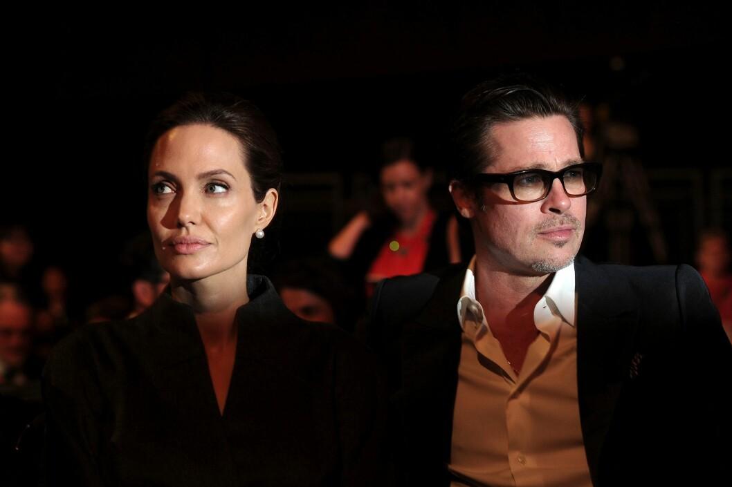 UENIGHETER: Ifølge amerikanske medier skal Angelina Jolie og Brad Pitt ha vært uenige om hvordan de skal leve livene sine og oppdra sine seks barn. Her er de avbildet sammen i juni 2014. Foto: Afp