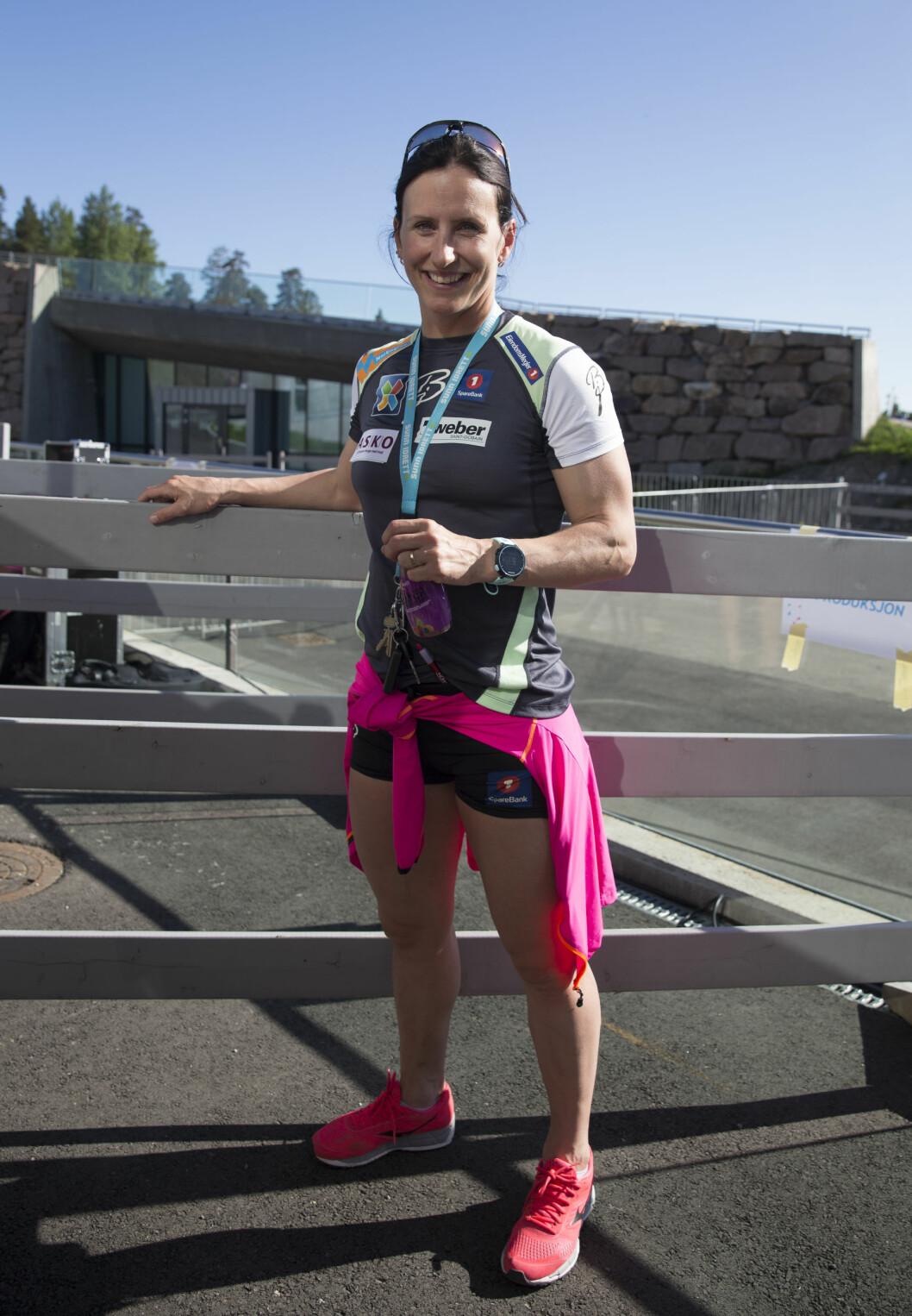 <strong>AKTIV MOR:</strong> Marit Bjørgen håper på å prestere under Lahti-VM i februar og mars neste år. Her er hun avbildet på Oslo Skishow 2016 i Holmenkollen i sommer, der hun ikke kunne delta på grunn av skade.  Foto: NTB scanpix