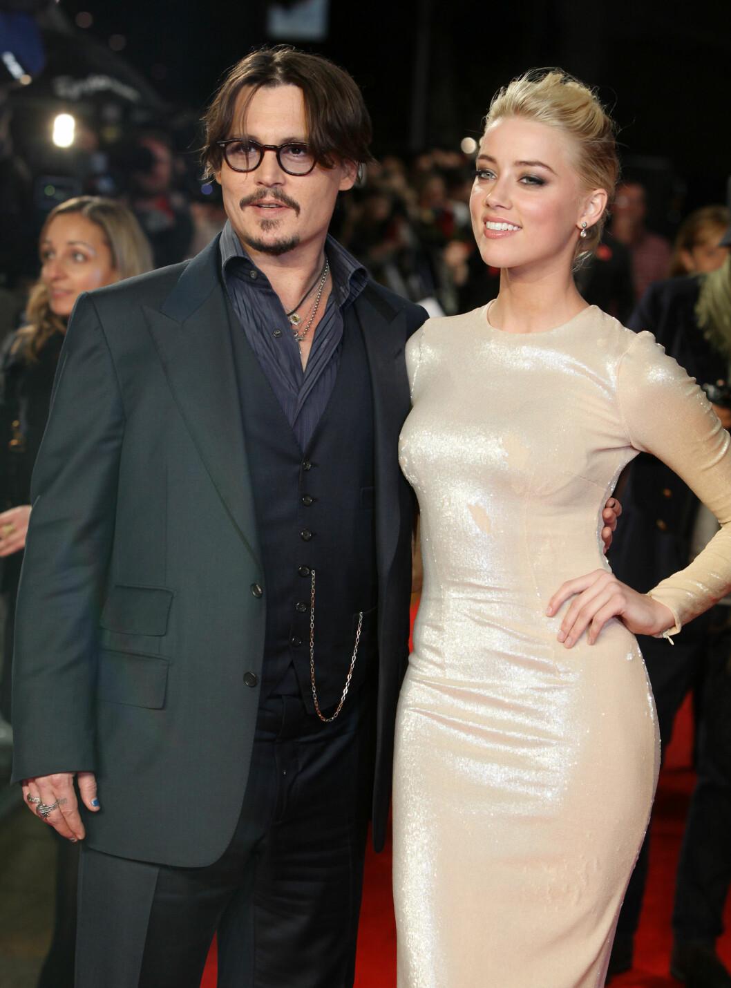 KORTVARIG EKTESKAP: Johnny Depp og Amber Heard annonserte skilsmissenyheten kun 15 måneder etter de giftet seg.  Foto: Ap