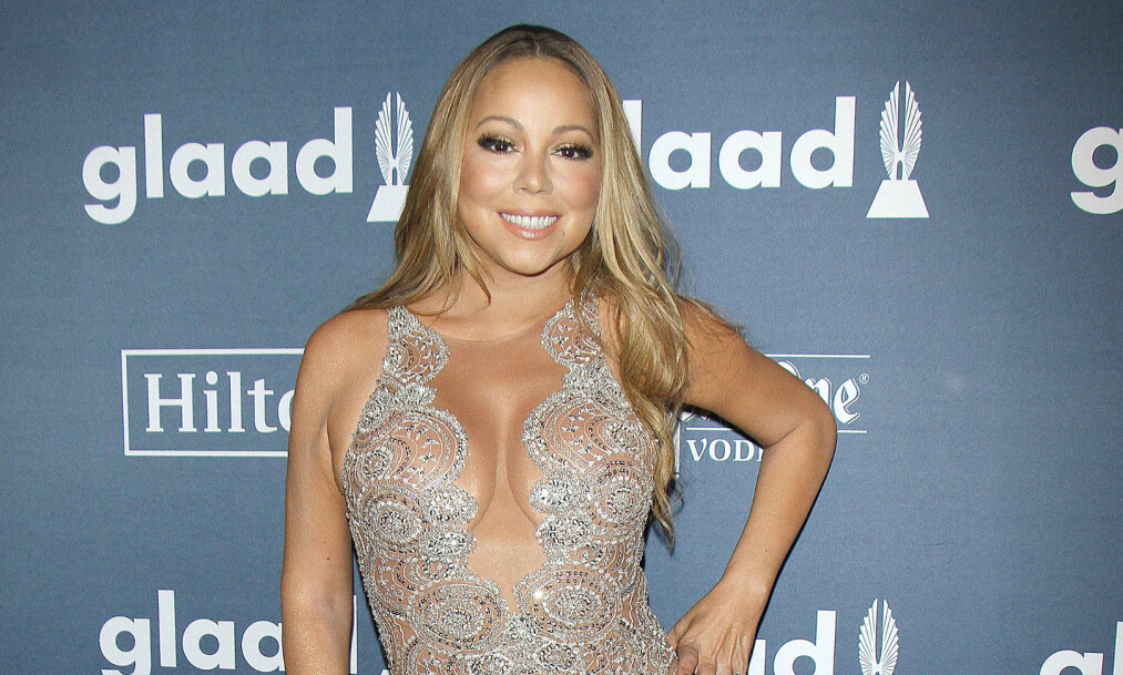 NY FLAMME: Mariah Carey brøt nylig med forloveden James Packer, men ligger ikke på latsiden. Denne uken ble hun og koreografen Bryan Tanaka foreviget av fotografer på stranden på Hawaii - mens de kysset intent. Foto: NTB scanpix