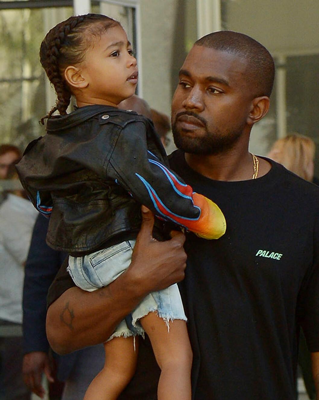 PAPPAJENTE: I desember ble Kanye West tobarnsfaren, da sønnen Saint kom til verden. Her er han sammen med sin søte datter North.  Foto: Broadimage