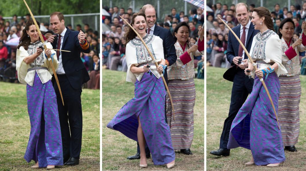LATTERMILDE: Selv om bueskytingen ikke gikk helt etter planen, moret hertuginne Kate og prins William seg kostelig mens de forsøkte seg på Bhutans nasjonalsport. Foto: NTB Scanpix