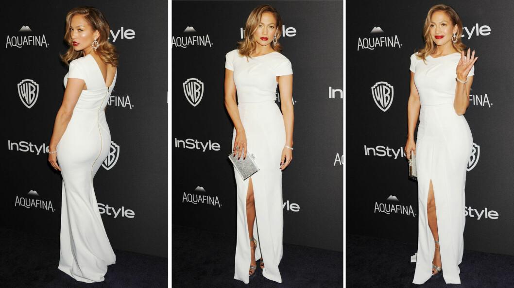 HEIT I HVITT: De noe ukledelige svetteringene på Golden Globe-løperen ble nok fort glemt da Jennifer Lopez viste sine berømte former i denne Roland Mouret-kjolen på etterfesten! Foto: Broadimage/ NTB Scanpix