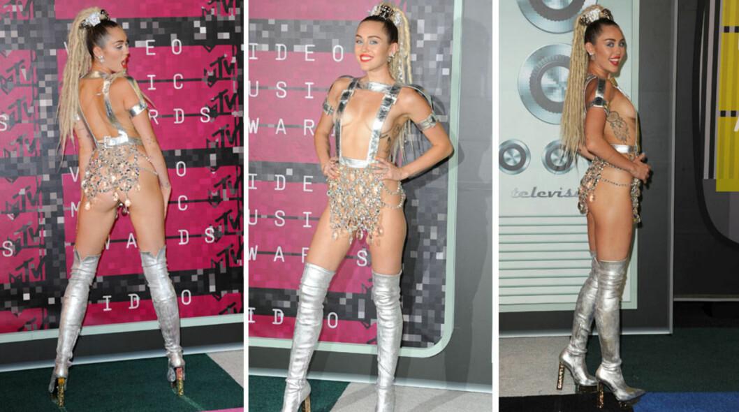 <strong>SJOKKERTE:</strong> Miley Cyrus benytter enhver anledning til å sjokkere og da hun var programleder under MTV Video Music Awards i august tok hun pusten fra de fleste. Artisten skiftet hyppig under forestillingen - det ene antrekket mer overveldende enn det neste. På den røde løperen hadde hun kun to sølvstropper som dekket brystene og et skjørt som lignet mest på en lysekrone. Antrekket var som skapt til å sjokkere - noe det gjorde til gangs.  Foto: NTB Scanpix