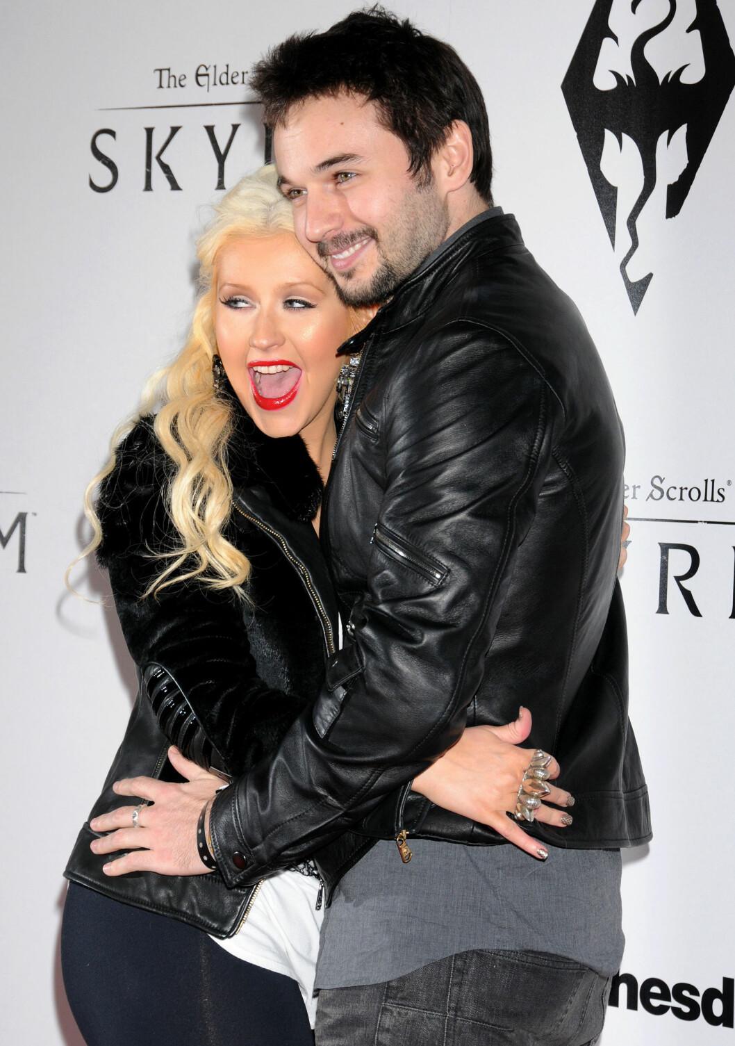 ÅPNET DØRENE: Christina Aguilera og Matt Rutler inviterte over 400 mennesker for å vise sin støtte til Hillary Clinton, men popstjernen skal ha endt opp med å stjele mye av oppmerksomheten selv. Foto: Stella Pictures
