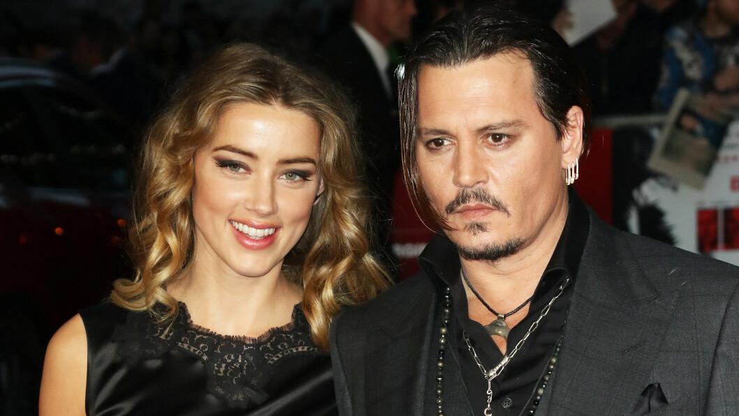 FLOTT PAR: Søndag kastet Amber Heard glans over premieren på ektemannen Johnny Depps siste film i London. Mens Depp poserte med steinansikt sjarmerte den søte blondinen de fremmøtte i senk.  Foto: Zuma Press