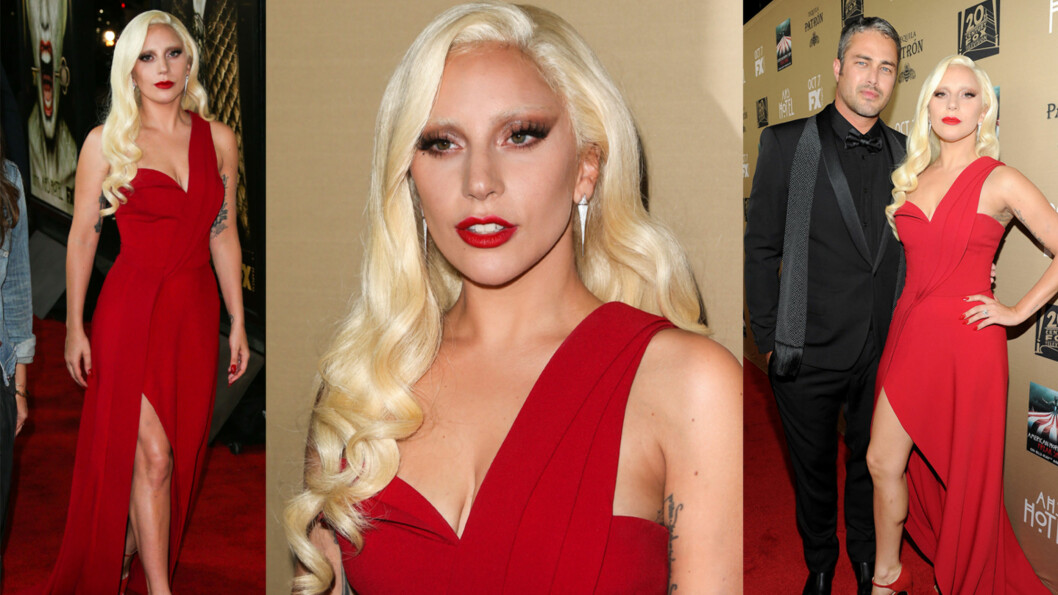 BLODRØD OG HEIT: Popstjernen Lady Gaga stilte i en spesialdesignet rød kjole, da hun og forloveden Taylor Kinney kastet glans over «American Horror Story: Hotel»-premieren i Los Angeles lørdag kveld. Dette er første rød løper-event Lady Gaga stiller på som skuespiller. Foto: NTB Scanpix