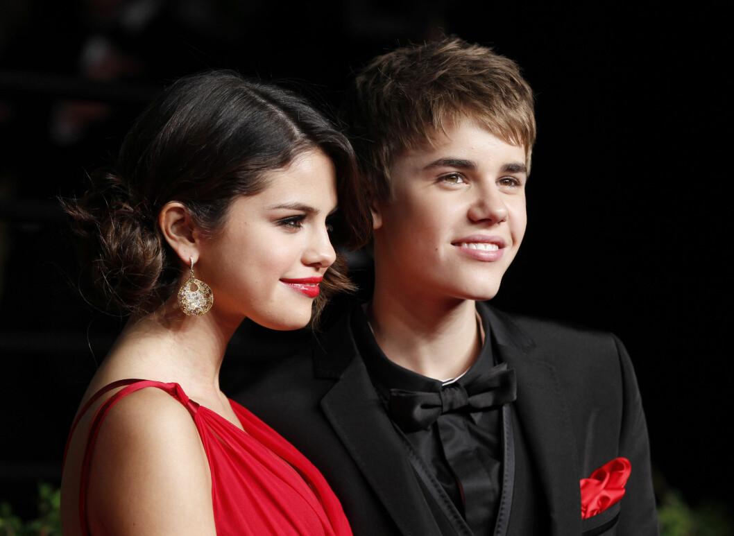 <strong>FRA LYKKELIGE TIDER:</strong> Forholdet til popstjernene Justin Bieber og Selena Gomez fikk enorm medieoppmerksomhet. Her er duoen sammen under Vanity Fairs Oscar-fest i Hollywood i 2011. Foto: Reuters