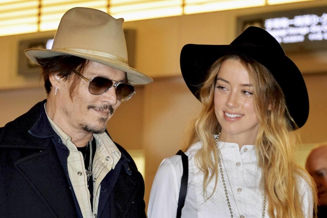 FORELSKET: Siden 2012 har Heard vært sammen med kjekkasen Johnny Depp, men hun har tidligere hatt jentekjærester. Foto: All Over Press
