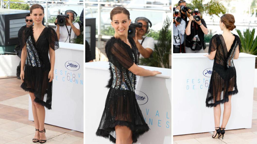 VISTE TRUSA: Hollywood-stjernen Natalie Portman er sjelden blant dem som viser mest hud for fotografene. Men på pressemøte i Cannes søndag, overrasket hun i denne gjennomsiktige kjolen fra Rodarte. Foto: NTB Scanpix