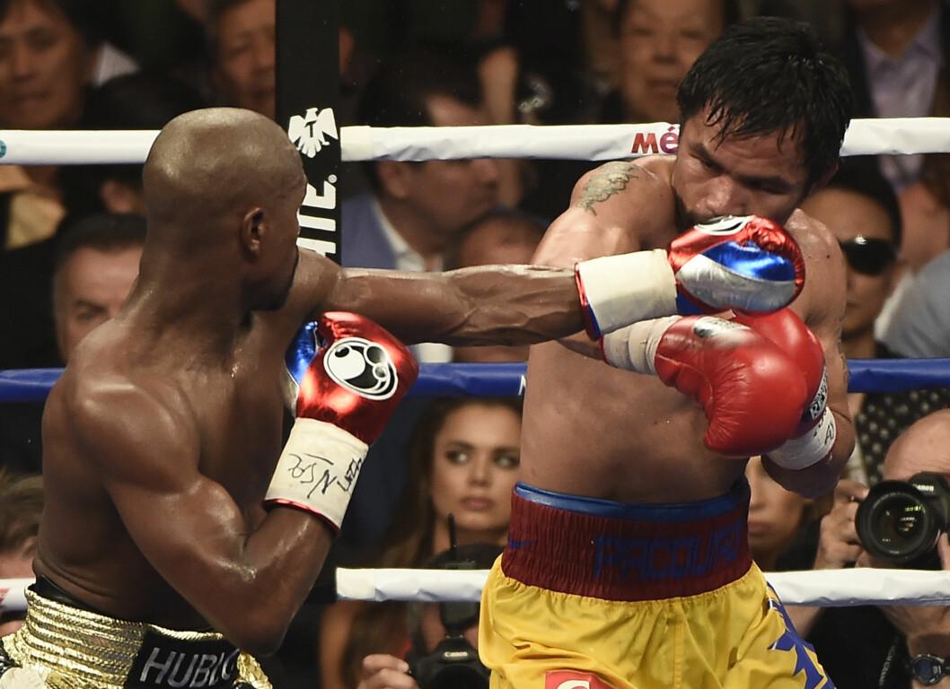 INNBITT DUELL: Floyd Mayweather, Jr. og Manny Pacquiao (t.h) knivet om mesterskapstittelen lørdag kveld.   Foto: Polaris