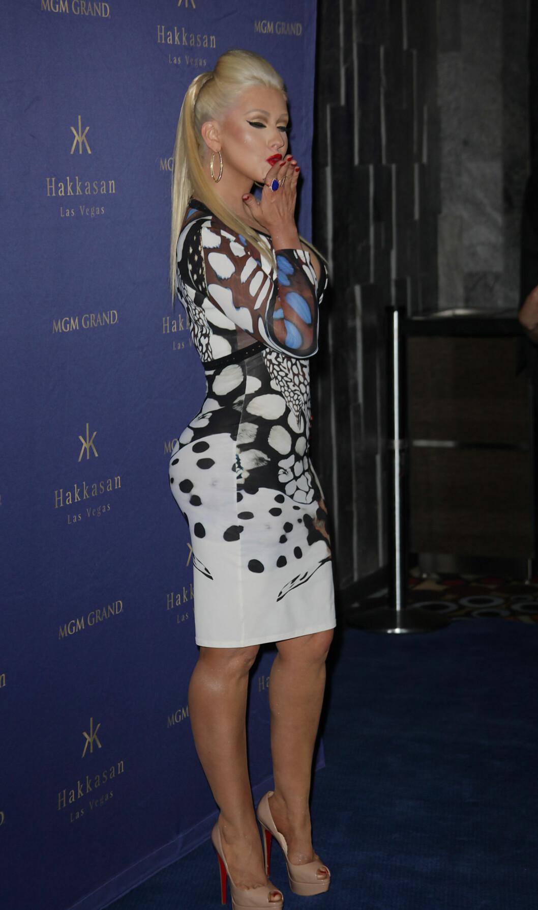 VISER SEG FREM: Christina Aguilera får mye oppmerksomhet om dagen etter hun dukket om i forlovedens bursdagsfest med en mye større bakdel enn før.  Foto: NTB Scanpix