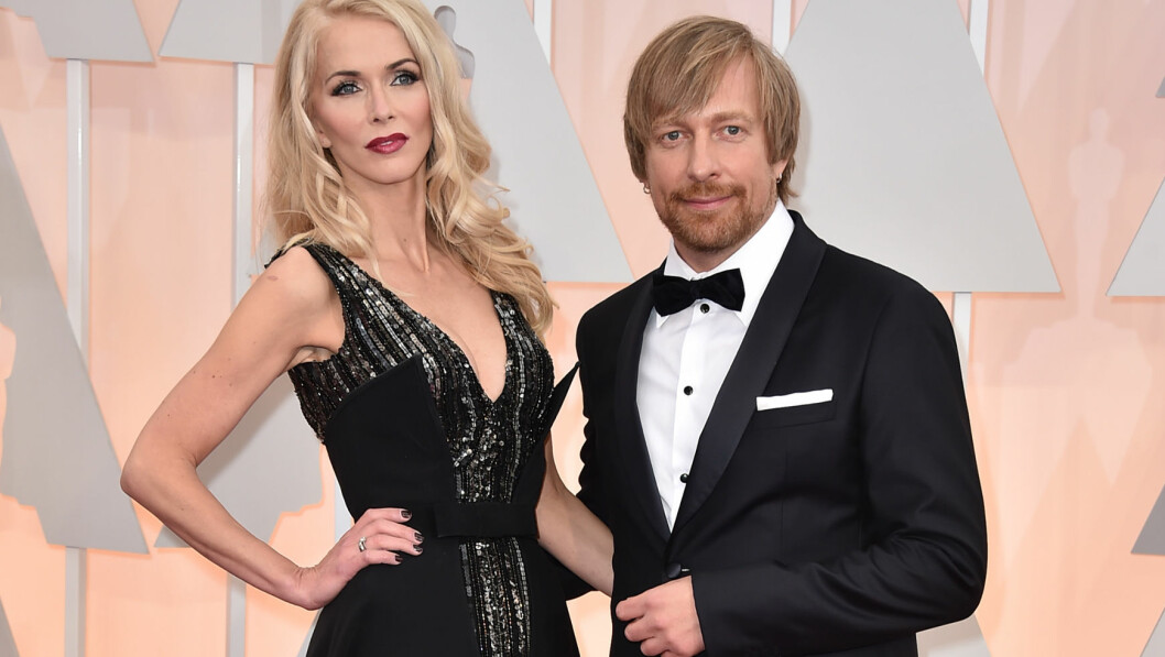 Morten Tyldum, right, and Janne Tyldum arrive at the Oscars on Sunday, Feb. 22, 2015, at the Dolby Theatre in Los Angeles. (Photo by Jordan Strauss/Invision/AP) Foto: Ap