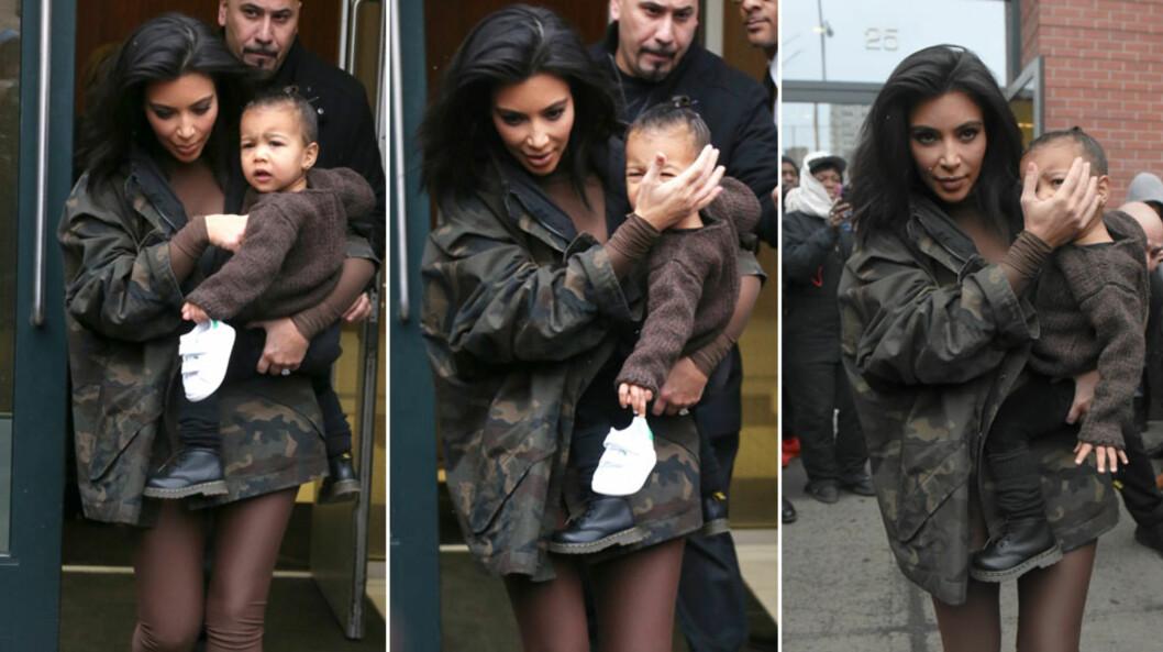 I DÅRLIG HUMØR: Lille North virket ikke særlig fornøyd da mamma Kim Kardashian fraktet henne ut fra motevisningen til pappa Kanye i New York torsdag. Flere av Daily Mails lesere mener den 20 mnd. gamle jenta ser utslitt ut. Foto: Stella Pictures