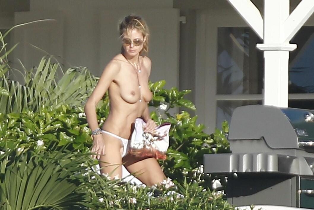 KASTET TOPPEN: Heidi Klum er kjent for sitt avslappete forhold til nakenhet, og benyttet anledningen til å kaste toppen da hun skulle sole seg lørdag. Foto: Stella Pictures