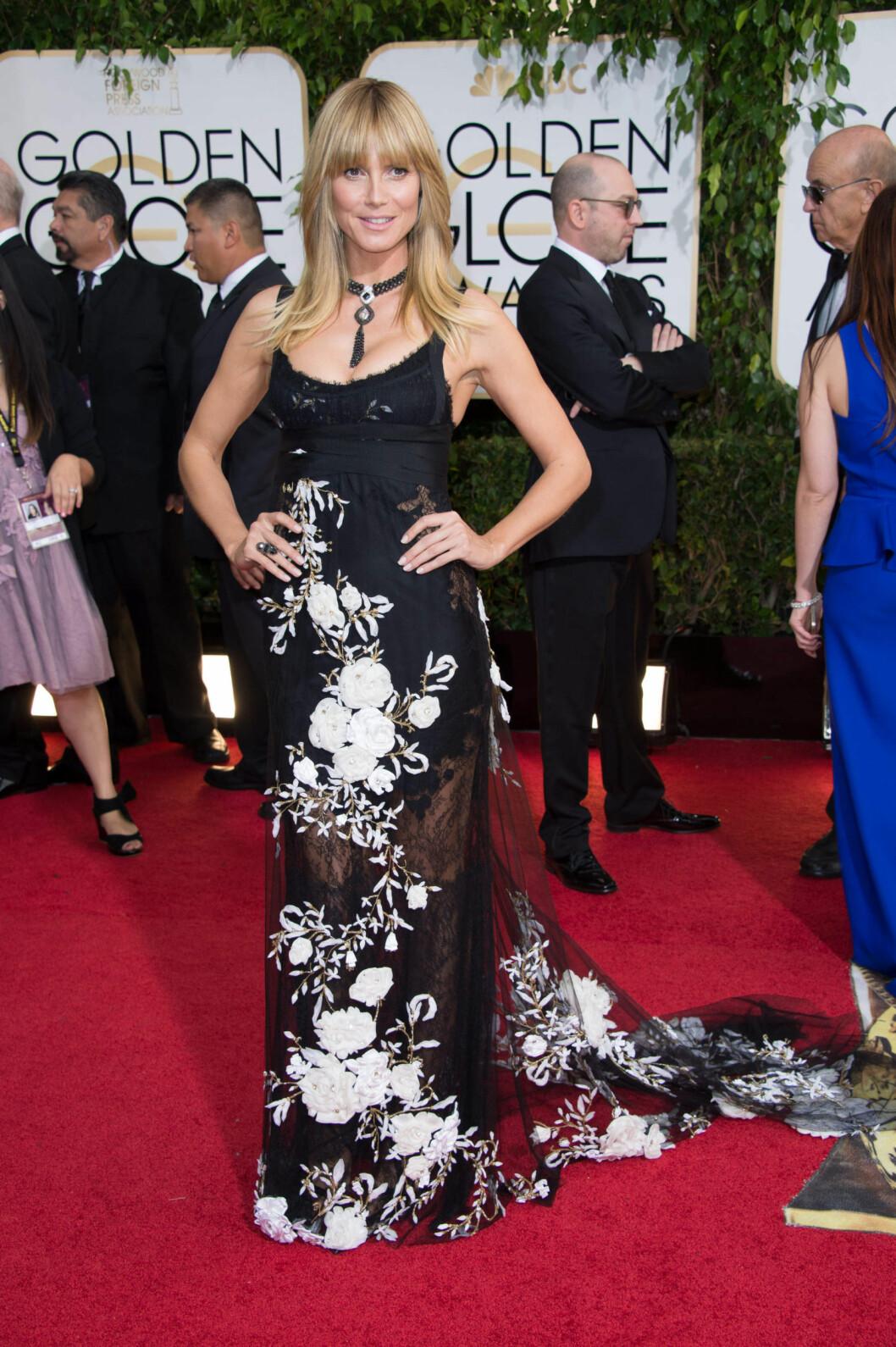 <strong>ENTEN ELLER:</strong> Supermodell Heidi Klum har en tendens til å variere mellom skivebom og innertier på den røde løperen. Antrekket hun valgte til Golden Globe i januar, gav henne ikke bedre score enn en toer på lesernes terning. Foto: Stella Pictures