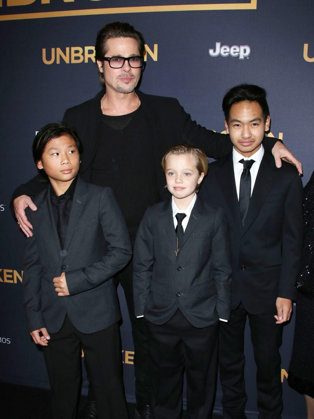 BRAD OG TRIO: Pitt hadde med seg barna Pax, Shiloh og Maddox på premieren til filmen Unbroken denne uken. Foto: All Over Press