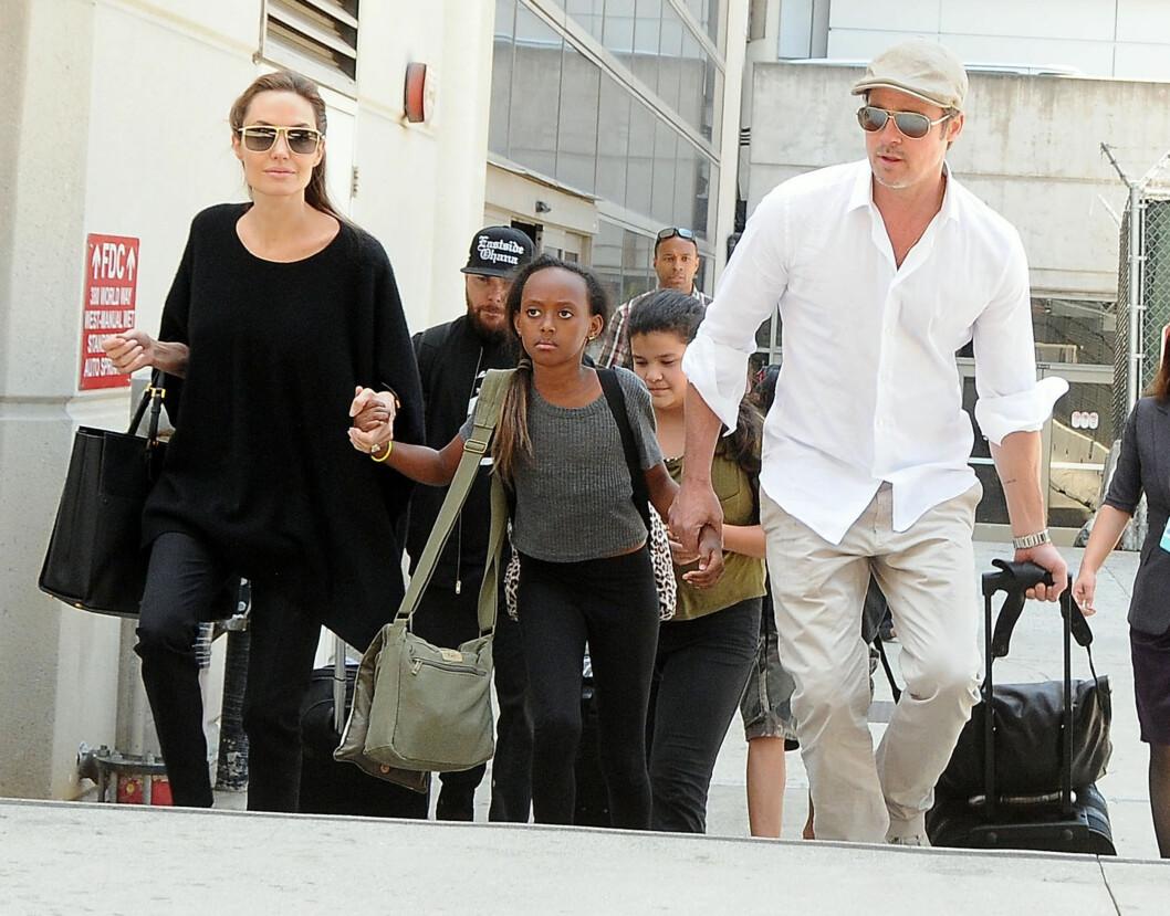 NÅ ER DE GIFT: Brad Pitt og Angelina Jolie har oppfylt barnas ønske om at de burde bli mann og kone. Foto: Stella Pictures