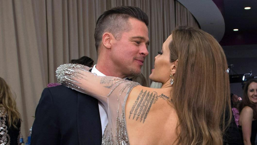 FORELSKET: Brad og Angelina la ikke skjul på sin forelskelse under årets Oscar-utdeling i Los Angeles. Foto: Stella Pictures