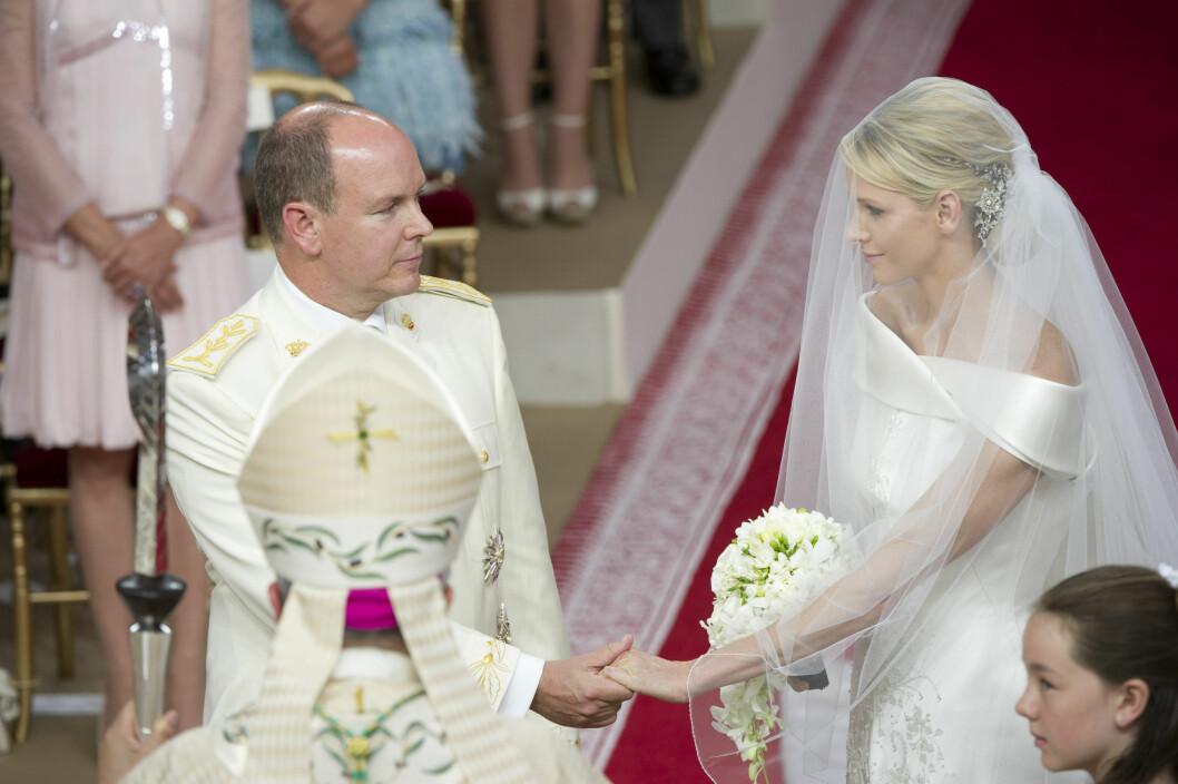 BRYLLUPSLYKKE: Prins Albert og den tidligere toppsvømmeren Charlene Wittstock giftet seg i Monaco i 2011. Først i en borgerlig seremoni, så i en storslått religiøs seremoni. Foto: Stella Pictures