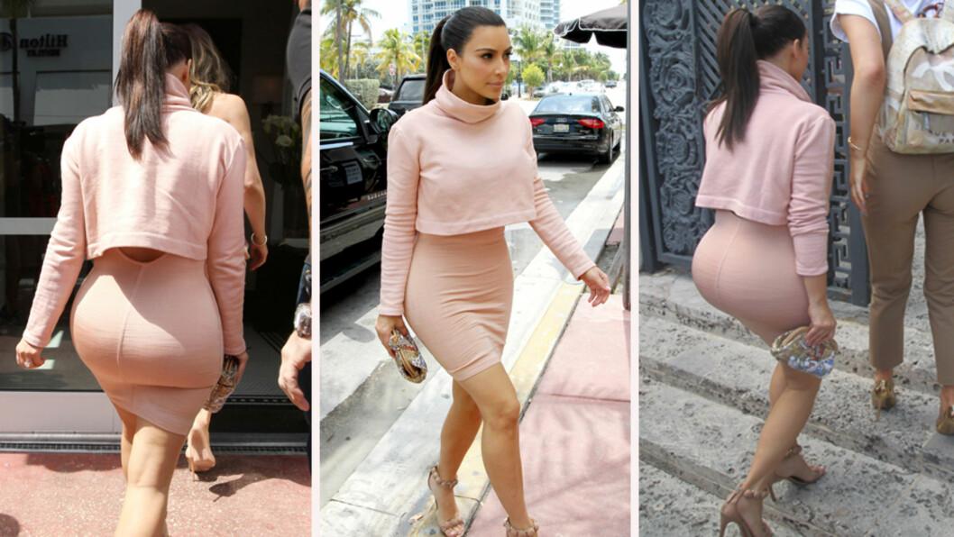 BERØMT BAK: Kim kardashians er kjent for sine generøse kurver som hun gjerne viser frem i trange antrekk.  Foto: All Over Press