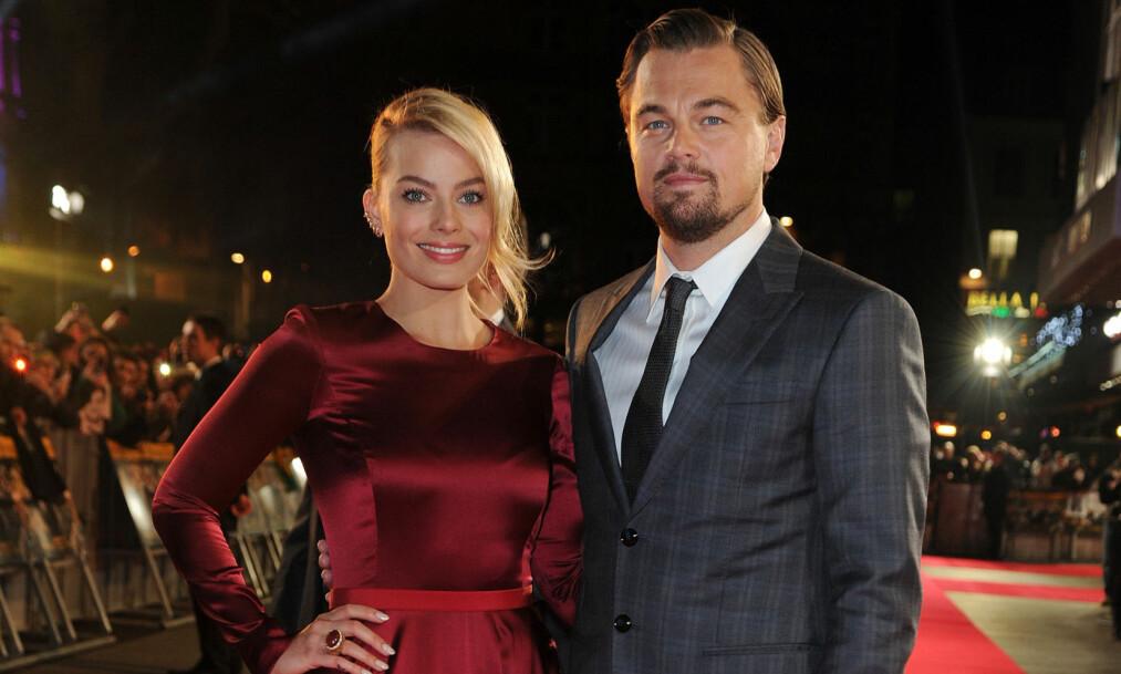 GIFTET SEG: Den unge Hollywood-stjernen Margot Robbie har giftet seg i all hemmelighet. Her er hun avbildet med Oscar-vinner Leonardo DiCaprio på «The Wolf of Wall Street»-premieren i London i 2014. Foto: NTB Scanpix