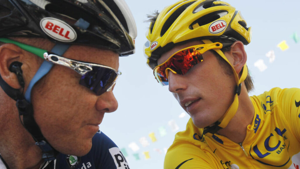 Andy Schleck of Luxembourg, wearing the overall leader's yellow jersey, right, talks to teammate Stuart O'Grady of Australia, left, prior to the start of the 11th stage of the Tour de France cycling race over 184.5 kilometers (114.6 miles) with start in Sisteron and finish in Bourg-les-Valences, France, Thursday, July 15, 2010. (AP Photo/Christophe Ena)