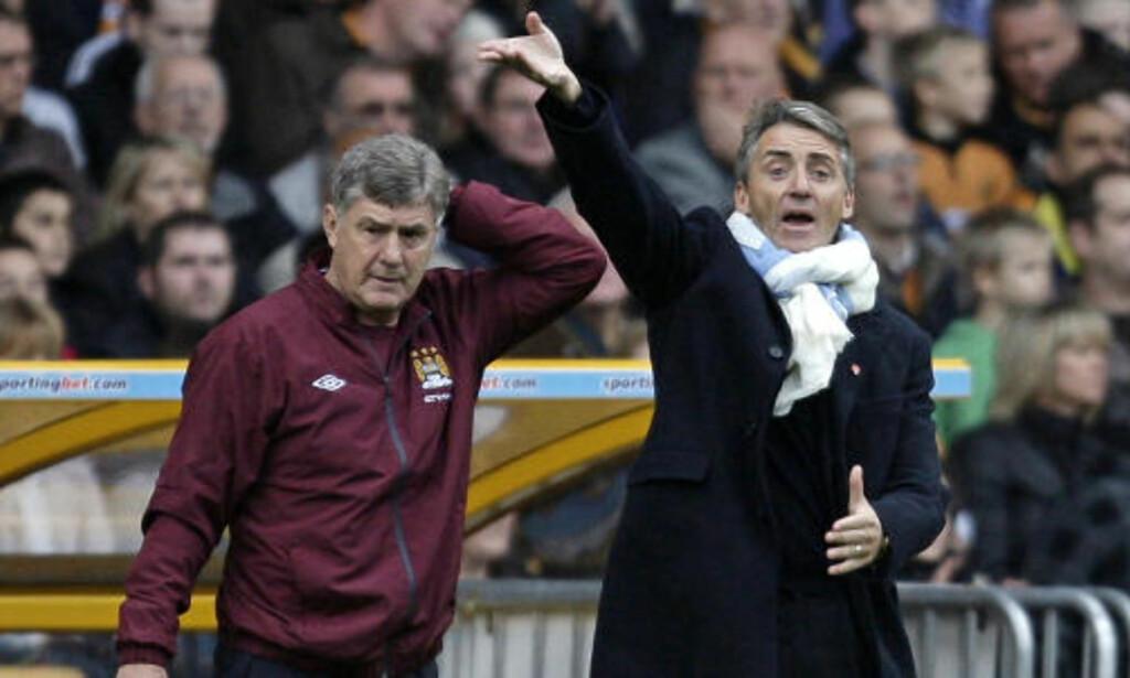 PRESSET ØKER: City-manager Roberto Mancini må leve med stadig flere rykter om splittelse i garderoben. Foto: IAN KINGTON/AFP